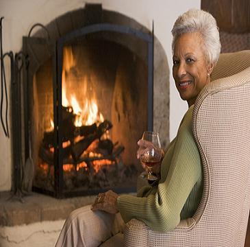 lady enjoying the fireplace