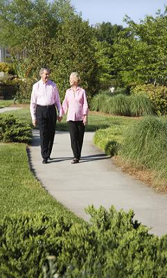 elderly couple out walking