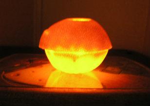 Lit Orange Candle