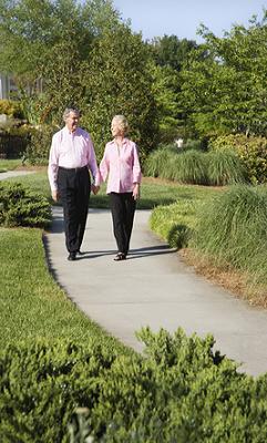 elderly couple out walking